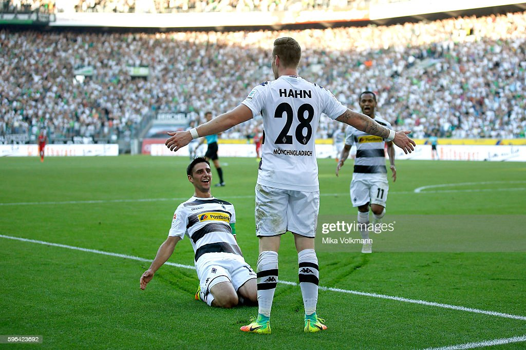 Andre Hahn of Moenchengladbach (M) celebrates scoring the 1:0 goal with Lars Stindl of Moenchengladbach (L) and Raffael of Moenchengladbach during the Bundesliga match between Borussia Moenchengladbach and Bayer 04 Leverkusen at Borussia-Park on August 27, 2016 in Moenchengladbach, Germany.