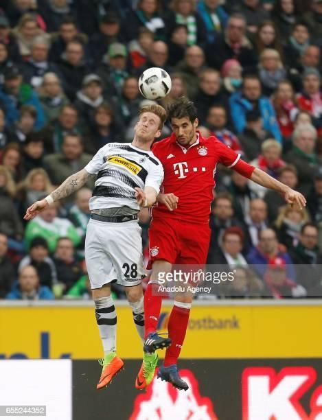 Andre Hahn of Moenchengladbach in action against Javier Martinez of Bayern Munich during the Bundesliga Match between Borussia Moenchengladbach and...