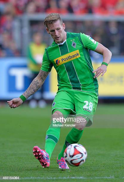 Andre Hahn of Moenchengladbach shoots ball during the Bundesliga match between SC Freiburg and Borussia Moenchengladbach at Mage Solar Stadium on...