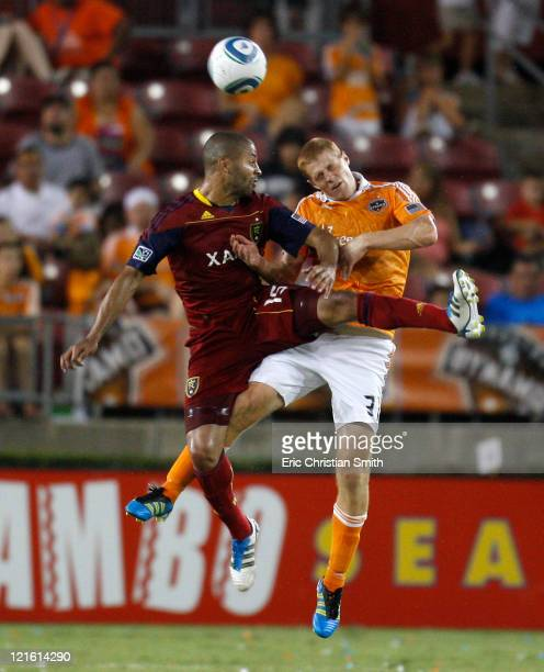 Andre Hainault of the Houston Dynamo heads the ball over Alvaro Saborio of Real Salt Lake in the second half at Robertson Stadium on August 20 2011...