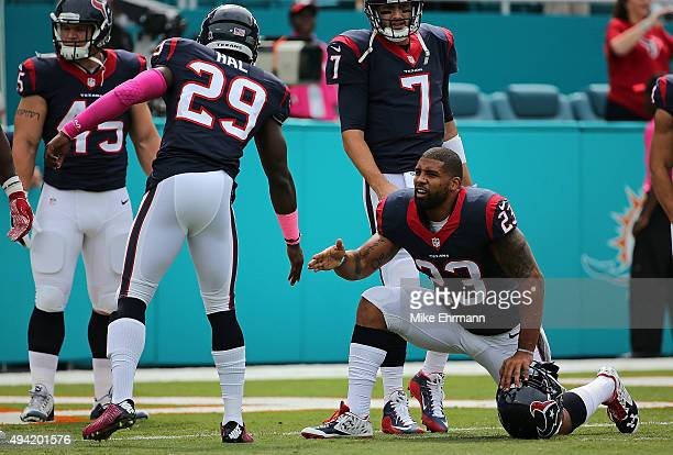 Andre Hal and Arian Foster of the Houston Texans warm up during a game against the Miami Dolphins at Sun Life Stadium on October 25, 2015 in Miami...