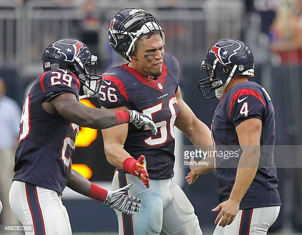 Andre Hal, Brian Cushing of the Houston Texans celebrates Randy Bullock of the Houston Texans 54 yard field goal against the Buffalo Bills in a NFL...