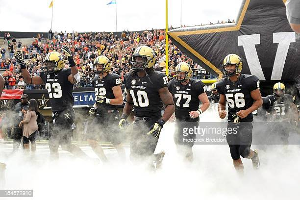 Andre Hal, Kris Kentera, Cory Batey, Spencer Pulley, and Darien Bryant of the Vanderbilt Commodores run out onto the field prior to a game against...