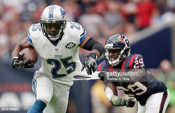 Andre Hal of the Houston Texans grabs the jersey of Theo Riddick of the Detroit Lions in the fourth quarter at NRG Stadium on October 30 2016 in...