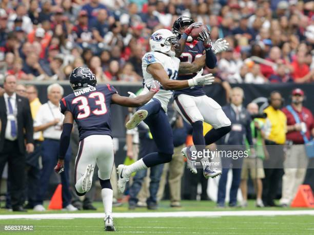 Andre Hal of the Houston Texans intercepts a pass intended for Rishard Matthews of the Tennessee Titans in the secound quarter at NRG Stadium on...