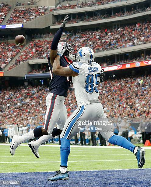 Andre Hal of the Houston Texans is called for pass interference against Eric Ebron of the Detroit Lions in the foruth quarter at NRG Stadium on...