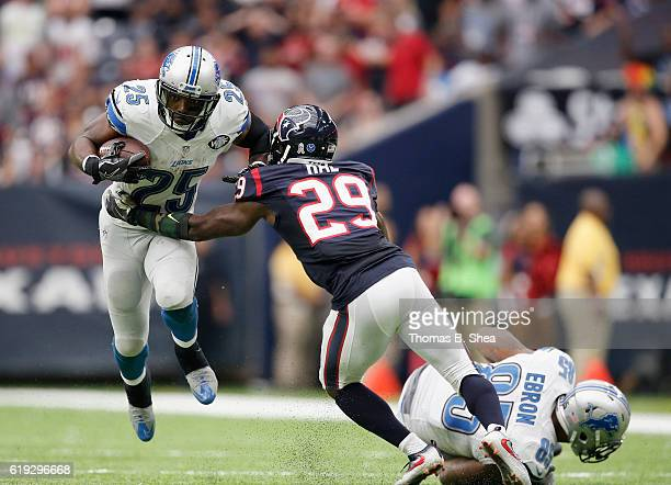 5db1608fa Andre Hal of the Houston Texans looks to make the tackle on Theo Riddick of  the