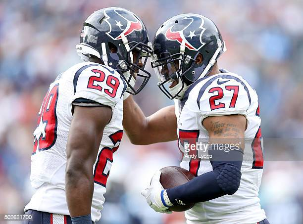 Andre Hall and Quintin Demps of the Houston Texans celebrate during the first quarter against the Tennessee Titans at LP Field on December 27 2015 in...