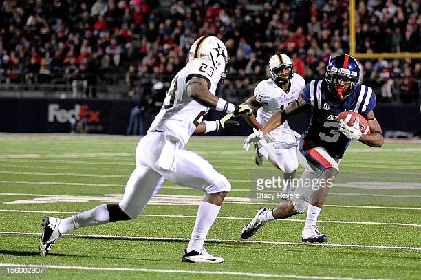 Andre Hall of the Vanderbilt Commodores pursues Jeff Scott of the Ole Miss Rebels during a game at VaughtHemingway Stadium on November 10 2012 in...