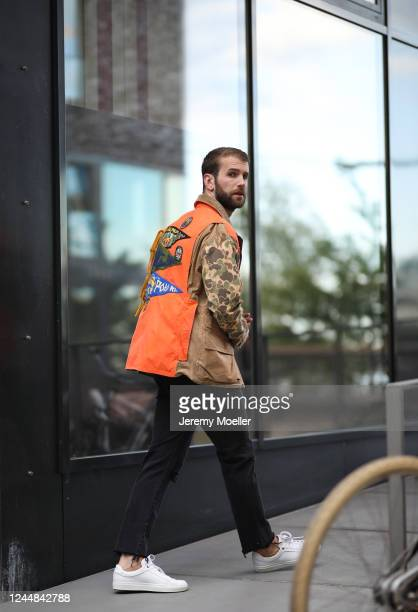 Andre Hamann wearing Polo Ralph Lauren jacket, Boss sneaker, Topman shirt and Mother jeans on May 29, 2020 in Hamburg, Germany.