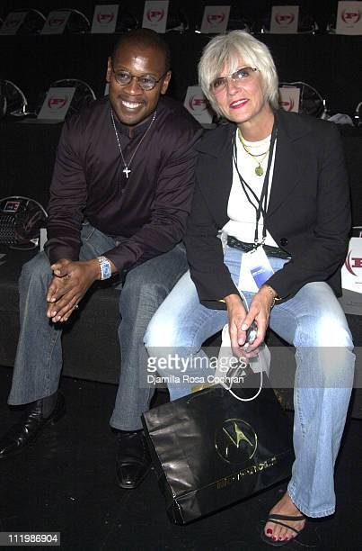 Andre Harrell and guest during MercedesBenz Fashion Week Spring Collections 2003 Phat Farm Show Front Row at Bryant Park in New York City New York...