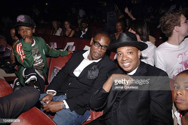Andre Harrell and Reverend Run during Olympus Fashion Week Spring 2006 Baby Phat Front Row and Backstage at Radio City Music Hall in New York City...