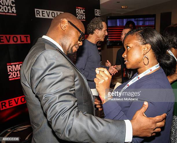 Andre Harrell and Shante Bacon attend Revolt Music Conference at Fontainebleau Miami Beach on October 17 2014 in Miami Beach Florida