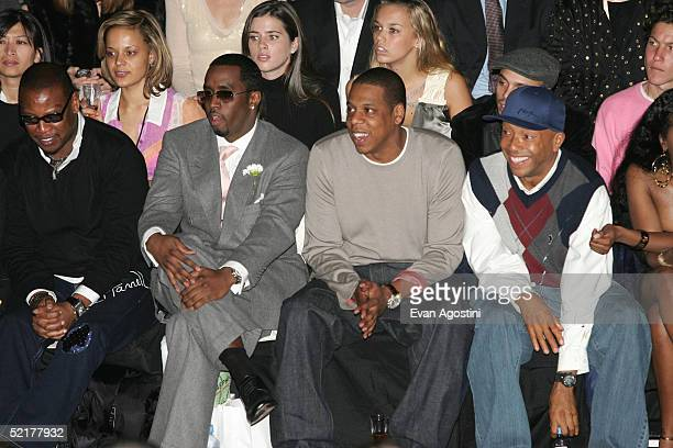 Andre Harrell Sean P Diddy Combs JayZ and Russel Simmons attend the Zac Posen Fall 2005 show during the Olympus Fashion Week in Bryant Park February...