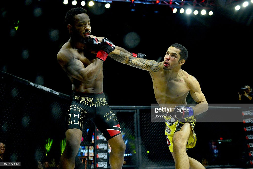 Andre Harrison fight Alexandre Bezerra in their Featherweight Title bout during the TITAN FC41 UFC fight event at Bank United Center on September 9, 2016 in Miami, Florida.