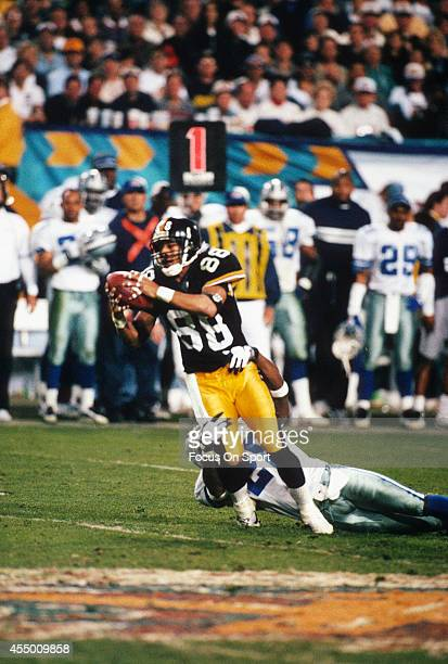 Andre Hastings of the Pittsburgh Steelers catches a pass any gets tackled by Darren Woodson of the Dallas Cowboys during Super Bowl XXX on January 28...