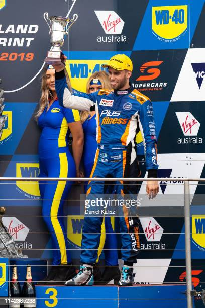 Andre Heimgartner driver of the Nissan Motorsport Nissan Altima celebrates on the podium during the Phillip Island 500 as part of the Supercars...
