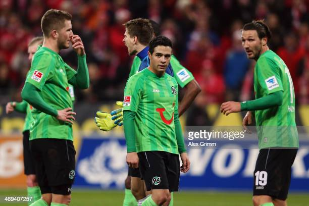 Andre Hoffmann Manuel Schmiedebach and Christian Schulz of Hannover react during the Bundesliga match between 1 FSV Mainz 05 and Hannover 96 at...