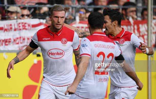 Andre Hoffmann of Duesseldorf celebrates after scoring his team's first goal during the Bundesliga match between Sport-Club Freiburg and Fortuna...
