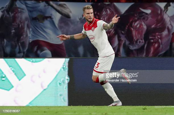 Andre Hoffmann of Fortuna Duesseldorf celebrates after scoring his team's second goal during the Bundesliga match between RB Leipzig and Fortuna...