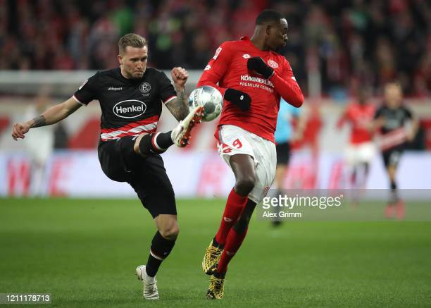 Andre Hoffmann of Fortuna Dusseldorf tackles Jean-Philippe Mateta of 1.FSV Mainz 05 during the Bundesliga match between 1. FSV Mainz 05 and Fortuna...