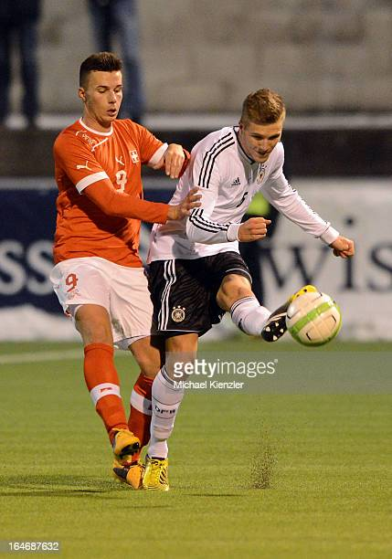Andre Hoffmann of Germany challenges Stjepan Vuleta during the international friendly match between U20 Switzerland and U20 Germany at Eps Stadium on...