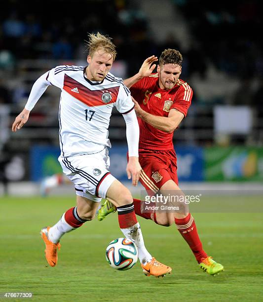 Andre Hofmann of Germany battles with Sergi Gomez during a friendly match German vs Spain on March 4 2014 in Palencia Spain