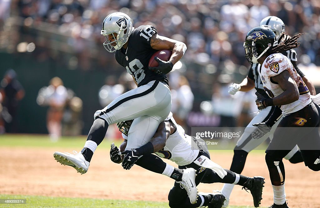 Andre Holmes #18 of the Oakland Raiders breaks a tackle against the Baltimore Ravens in the first quarter at Oakland-Alameda County Coliseum on September 20, 2015 in Oakland, California.