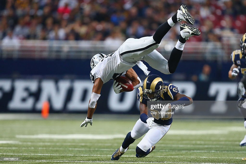 Andre Holmes #18 of the Oakland Raiders is tackled by E.J. Gaines #33 of the St. Louis Rams in the second quarter at the Edward Jones Dome on November 30, 2014 in St. Louis, Missouri.