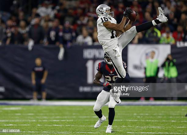 Andre Holmes of the Oakland Raiders leaps to catch a pass against the Houston Texans in their AFC Wild Card game at NRG Stadium on January 7, 2017 in...
