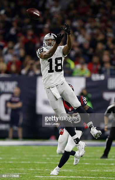 Andre Holmes of the Oakland Raiders leaps to catch a pass against the Houston Texans in their AFC Wild Card game at NRG Stadium on January 7 2017 in...