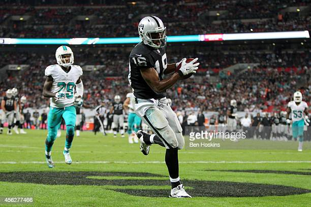 Andre Holmes of the Oakland Raiders makes a 22 yard reception to score his team's second touchdown during the NFL match between the Oakland Raiders...