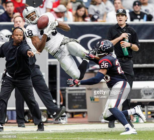 Andre Holmes of the Oakland Raiders makes a catch as he beats Brandon Harris of the Houston Texans on the play in the third quarter at Reliant...