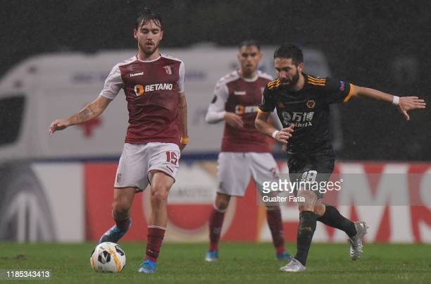 Andre Horta of SC Braga with Joao Moutinho of Wolverhampton Wanderers in action during the Group K UEFA Europa League match between SC Braga and...