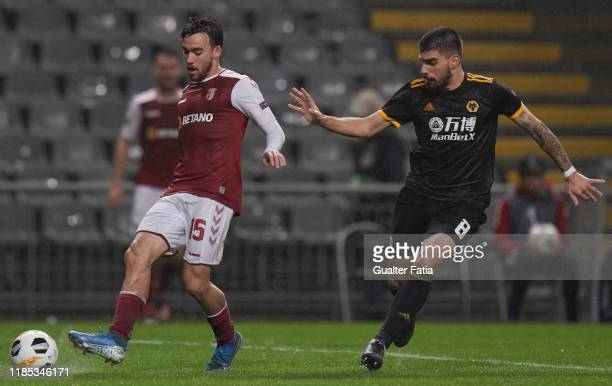 Andre Horta of SC Braga with Ruben Neves of Wolverhampton Wanderers in action during the Group K UEFA Europa League match between SC Braga and...