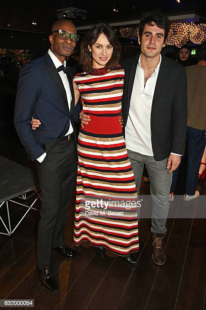 Andre Howard Gayle Olga Kurylenko and Ben Cura attend The Fall Magazine launch party in the Rumpus Room at Mondrian London on January 18 2017 in...