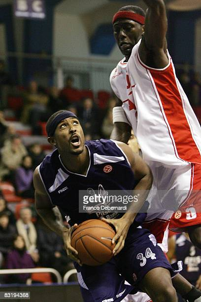 Andre Hutson of Efes Pilsen Istanbul and Ansu Seasy of Armani Jeans Milano and Nicholas Drew of Efes Pilsen Istanbul in action during the Euroleague...