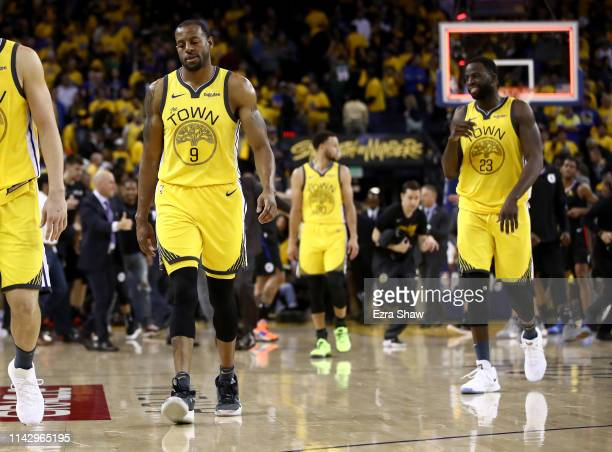 Andre Iguodala and Draymond Green of the Golden State Warriors walk off the court after they lost to the LA Clippers during Game Two of the first...