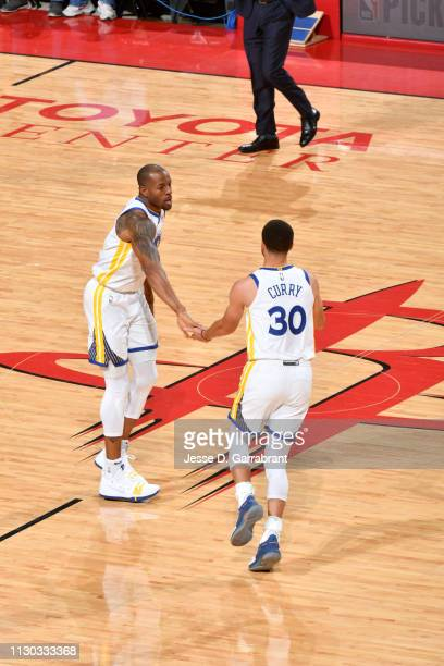 Andre Iguodala and Stephen Curry of the Golden State Warriors highfive during a game against the Houston Rockets on March 13 2019 at the Toyota...