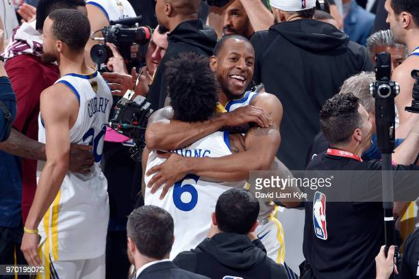 OH Andre Iguodala hugs Nick Young of the Golden State Warriors as they celebrate a victory over the Cleveland Cavaliers in Game Four of the 2018 NBA...