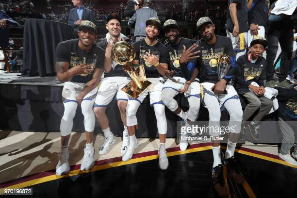 Andre Iguodala, Klay Thompson, Stephen Curry, Draymond Green, and Kevin Durant of the Golden State Warriors pose with the Larry O'Brien Championship...