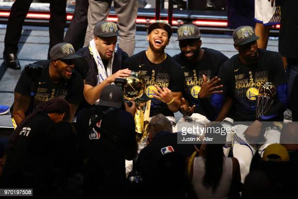 Andre Iguodala Klay Thompson Stephen Curry Draymond Green and Kevin Durant of the Golden State Warriors celebrate after defeating the Cleveland...