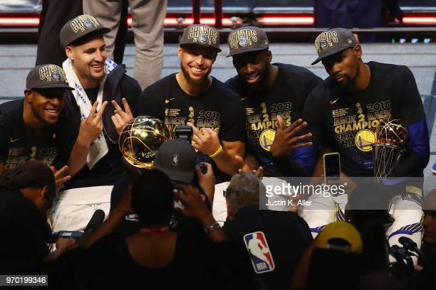 Andre Iguodala, Klay Thompson, Stephen Curry, Draymond Green and Kevin Durant of the Golden State Warriors celebrate after defeating the Cleveland...