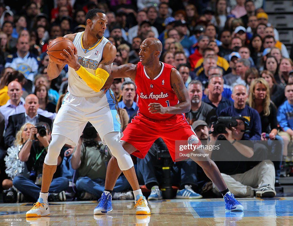 Andre Iguodala #9 of the Denver Nuggets controls the ball against Chauncey Billups #1 of the Los Angeles Clippers at the Pepsi Center on March 7, 2013 in Denver, Colorado.