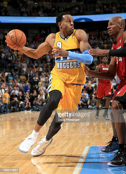 Andre Iguodala of the Denver Nuggets controls the ball against Ray Allen of the Miami Heat at the Pepsi Center on November 15 2012 in Denver Colorado...