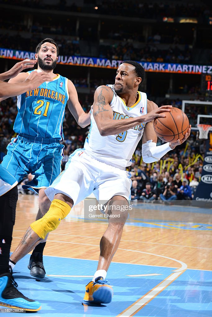 Andre Iguodala #9 of the Denver Nuggets handles the ball against Greivis Vasquez #21 of the New Orleans Hornets on February 1, 2013 at the Pepsi Center in Denver, Colorado.