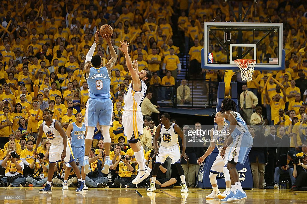 Andre Iguodala #9 of the Denver Nuggets shoots against Andrew Bogut #12 of the Golden State Warriors during Game Six of the Western Conference Quarterfinals of the 2013 NBA Playoffs at ORACLE Arena on May 2, 2013 in Oakland, California.