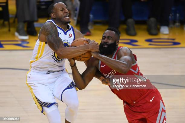 Andre Iguodala of the Golden State Warriors and fights for possesion with James Harden of the Houston Rockets during Game Three of the Western...