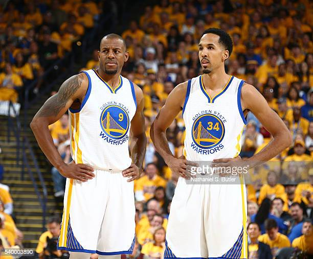 Andre Iguodala of the Golden State Warriors and Shaun Livingston looks on during the game against the Cleveland Cavaliers in Game Five of the 2016...