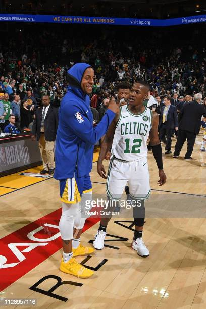 Andre Iguodala of the Golden State Warriors and Terry Rozier of the Boston Celtics talk after a game on March 5 2019 at ORACLE Arena in Oakland...